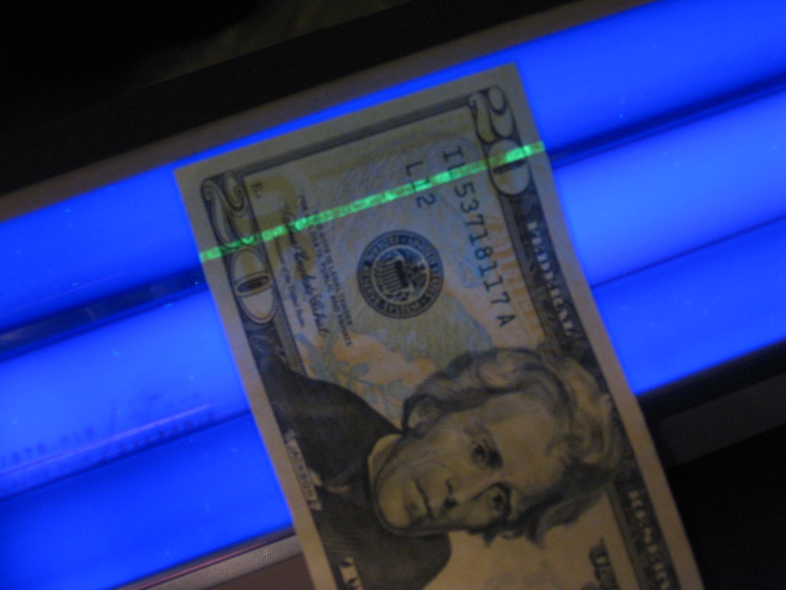 U.S. money under a blacklight