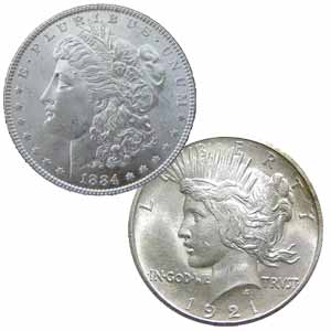 A closeup of two authentic versions of the Morgan silver dollar that are a part of the rare coin collection at Atlanta Gold & Coin Buyers in Johns Creek, GA