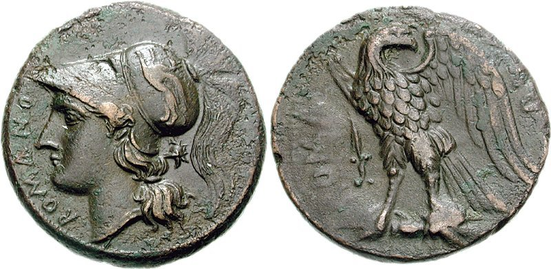 Close up of the front and back of a Roma Minerva Eagle coin