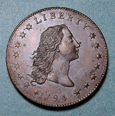 Close-up of the Flowing Hair silver dollar, a rare coin from Atlanta Gold & Coin Buyers in Duluth, GA